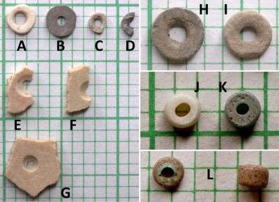 Figure 5. Mafunyane's bead assemblage: A–G, ostrich eggshell beads in various production stages, J & K, European possibly dating from the eighteenth century; and L, European red-on-green (AD 1600–1800s).