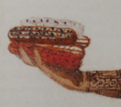 Figure 5. Detailed view of figure 3, showing maize cobs in the woman's right hand.