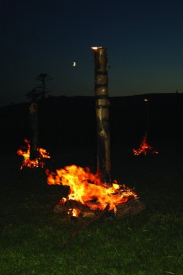 Figure 1. The timber circle on fire during the first 'Burning the Circle' event in summer 2013 (photograph: Steven Watt).