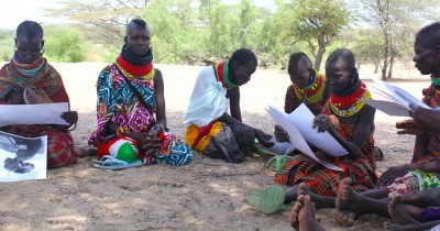 Figure 4. Group photograph-elicitation session held with women at Kangarisae market, south Turkana, September 2014.