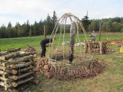 Figure 4. Pyres being constructed in advance of our second Arran 'Build 'N' Burn' event, in September 2014; this took place within the charred remnants of the original timber circle (photograph: Kenneth Brophy).